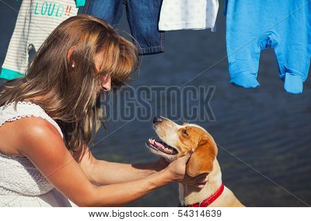 Pregnant Lady While Patting Her Dog