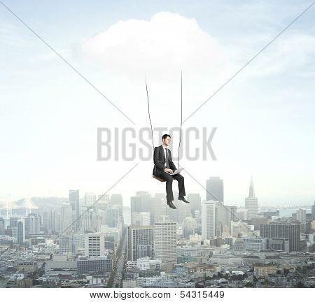 Man Sitting On A Swing