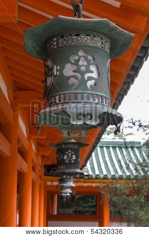 A Row Of Decorative Metal Lanterns At Heian Jingu Shrine In Kyoto, Japan