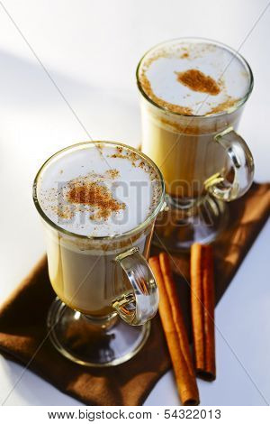 Two Mugs Of Frothy Hot Chocolate With Cinnamon