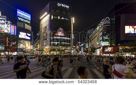 Crowds Of People At Shibuya Crossing In Tokyo, Japan.