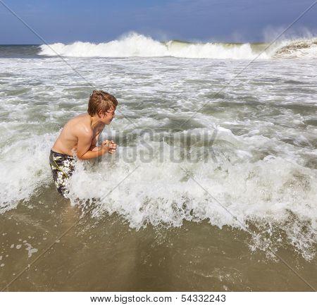 Boy Enjoys The Waves Of The Sea