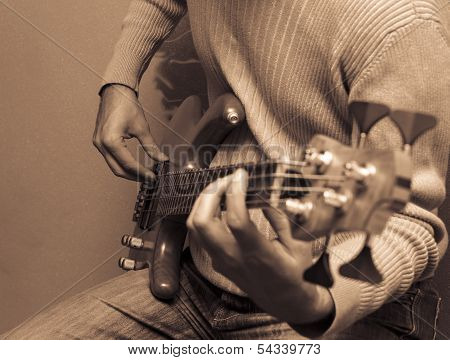 Guitarist Playing A Bass Guitar