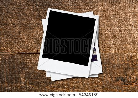 Blank Photo Frames On Old Wooden Background.