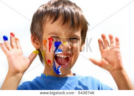 Kid With Color On His Fingers And Face  Yelling