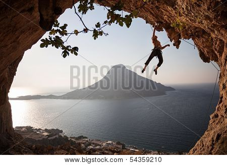 Rock climber at sunset. Kalymnos, Greece.