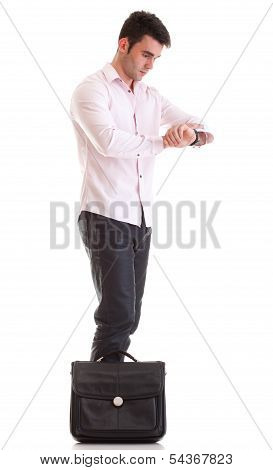 Young Attractive Businessman With Briefcase Impatient