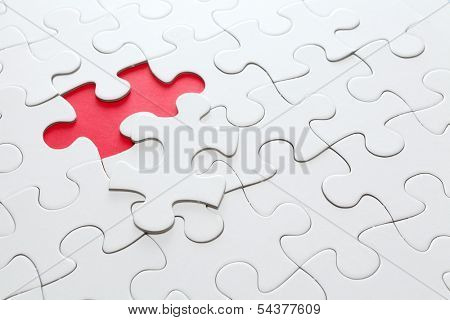 Missing jigsaw piece in red.