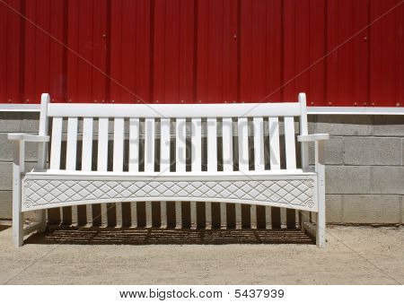 White Bench And Red Wall
