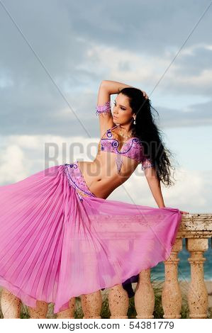 Belly Dancer In Pink Costume On Balustrade