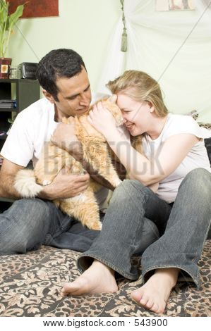 Loving Couple With Cat