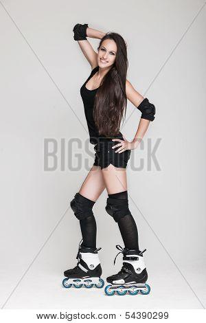 Beautiful woman in roller skates