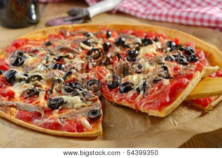 Pizza with anchovies, olives, cheese, and tomato