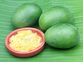 stock photo of bengali  - Green mango with kasundi  - JPG