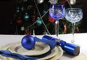 Beautiful Christmas Table Setting In Front Of Christmas Tree, With Blue Theme Crystal Wine Goblet Gl