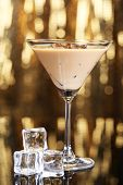 image of bailey  - Baileys liqueur in glass on golden background - JPG