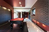 stock photo of snooker  - Snooker table in a luxury interior with brick walls - JPG