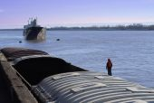 Cargo Ship And Barge With One Deck Hand