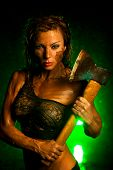 image of ax  - Young strong woman with axe - JPG