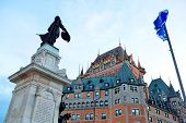 foto of chateau  - Chateau Frontenac with statue at dusk in Quebec City - JPG