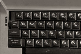 stock photo of qwerty  - Dirty Old Typewriter with Traditional QWERTY Keys - JPG