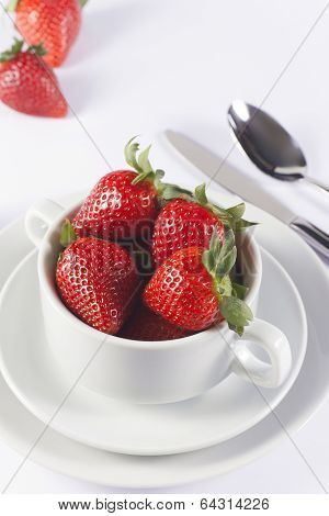 Festive Table Set With Strawberry In Bowl On White Background
