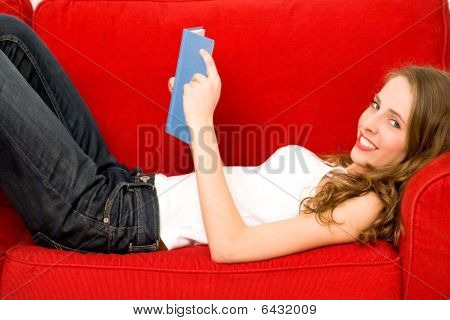 Young woman lying on couch