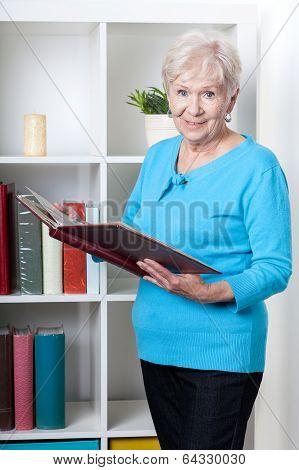 Senior Woman Viewing Photo Album