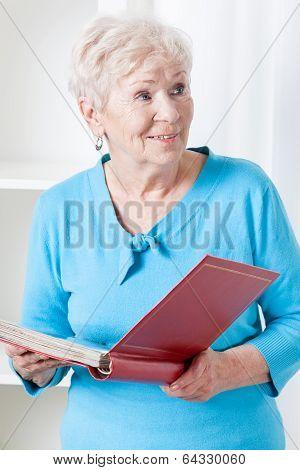 Elderly Woman With Photo Album