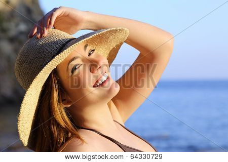 Portrait Of A Happy Woman With Perfect White Smile On The Beach
