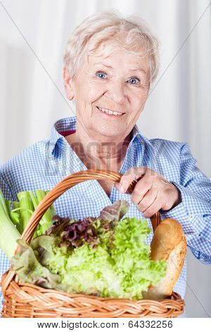 Elderly Woman Holding Basket