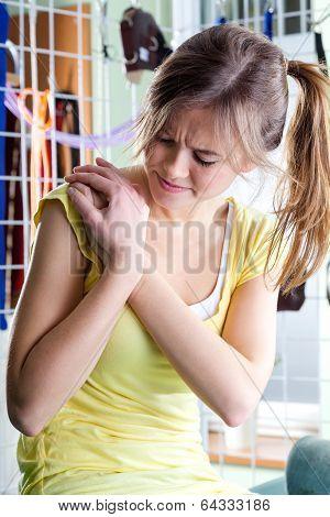 Woman Rubbing Aching Shoulder