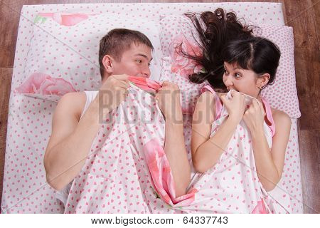 Young Couple Scare Each Other In Bed