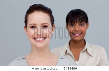 Portrait Of A Smiling Caucasian And An Afro-american Businesswomen