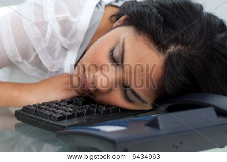Young Businesswoman Sleeping On The Keyboard