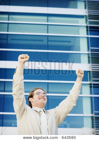 Businessman Raises His Arms