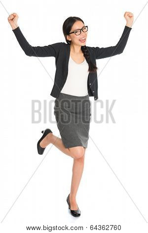 Full body Asian business woman, jumping with arms raised celebrating success isolated white background.