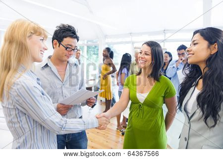 Two Smart-Casual Women Having a Handshake