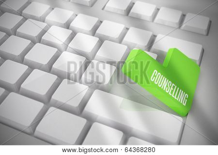 The word counselling on white keyboard with green key