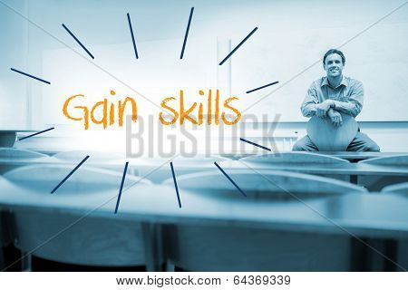 The word gain skills against lecturer sitting in lecture hall
