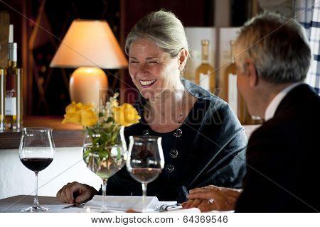 Senior couple having dinner at the restaurant