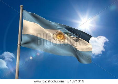 Argentina national flag on flagpole on blue sky background