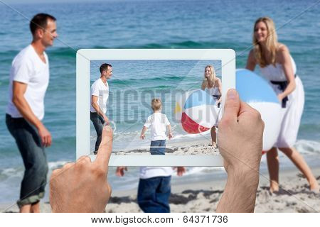 Hand holding tablet pc against many feathers blowing in the breeze