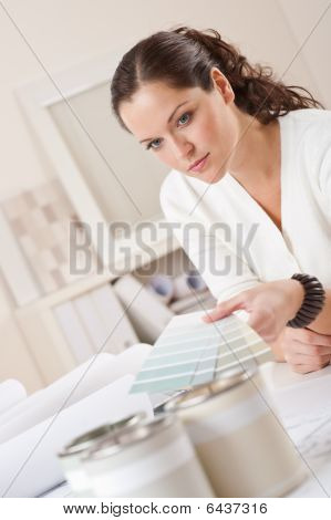 Young Female Interior Designer Working At Office