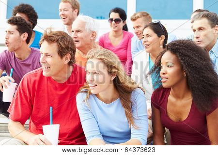Crowd Of Spectators Watching Outdoor Sports Event