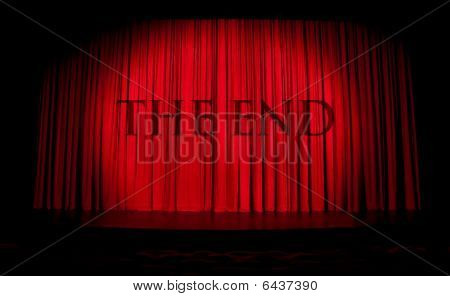 Red stage curtain with spotlight and with THE END inscription