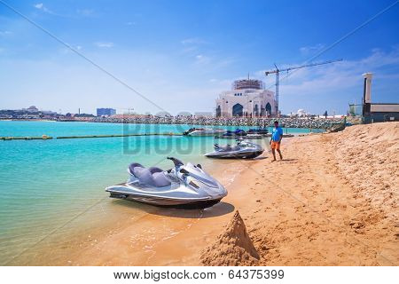 ABU DHABI, UAE - MARCH 28: Jetski for rent on the beach of Khalidiya Palace by Rotana on March 28, 2014, UAE. Rotana Hotel Corporation has 85 properties in 26 cities around Middle East and Africa.
