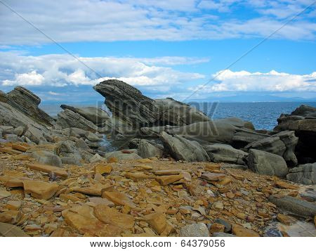 Sea landscape with intricate stones (boulders)