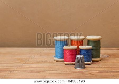 Spools Of Thread And Thimble