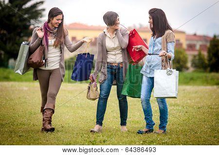 Three Happy Girls Doing Shopping